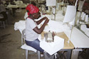 Haitian woman working in a factory